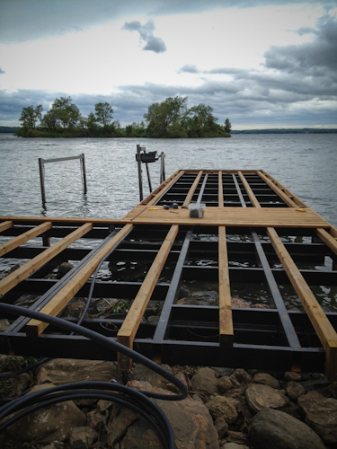 Wood Being Installed on Permanent Dock on Island